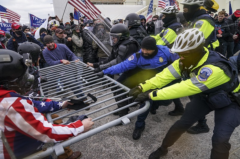 Trump supporters try to break through a police barrier, Wednesday, Jan. 6, 20...