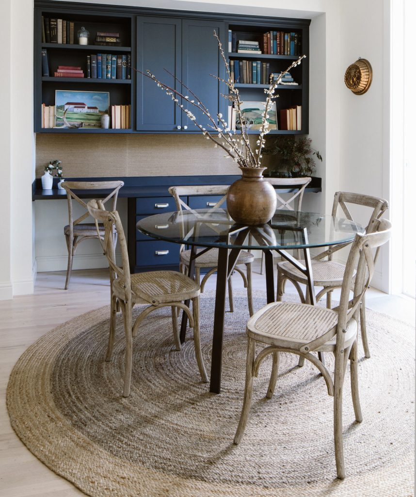 Glass breakfast table with navy built-in, double workstation and neutral jute rug