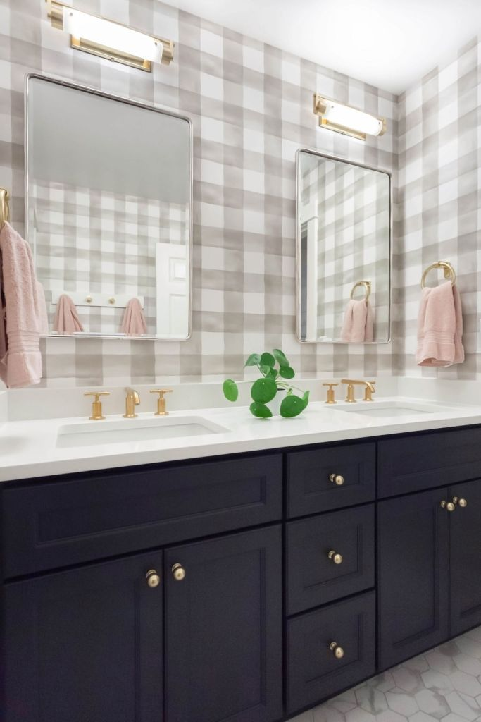 Girl's Bathroom with checkered wallpaper and mixed metal finishes in Redmond, WA