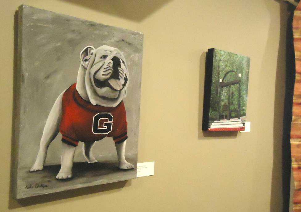 "Two UGA themed paintings by Katie Phillips; ""Damn Good Dawg"" (left) and ""The Arch"" (right)."