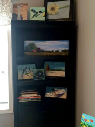 The new bookcase - perfect for displaying my paintings!