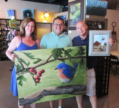 """These collectors bought several of my paintings, including my signature piece """"Bluebird and His Berries""""."""
