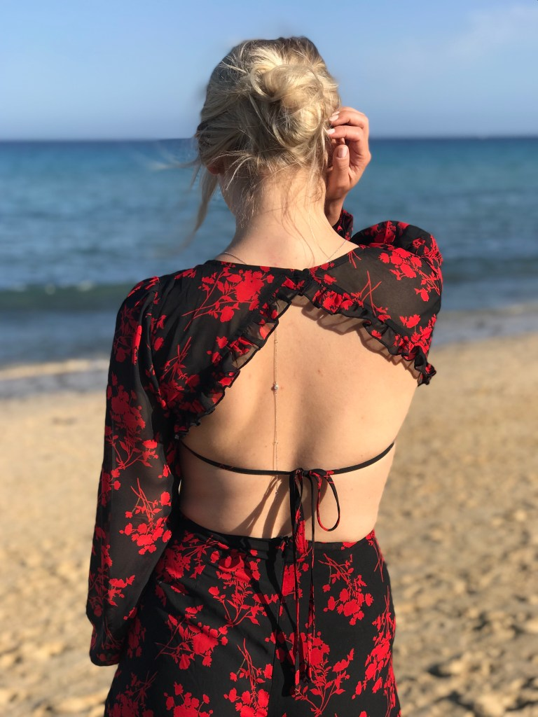 woman on the beach floral jumpsuit