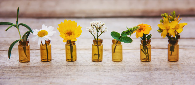 small flowers in small bottles