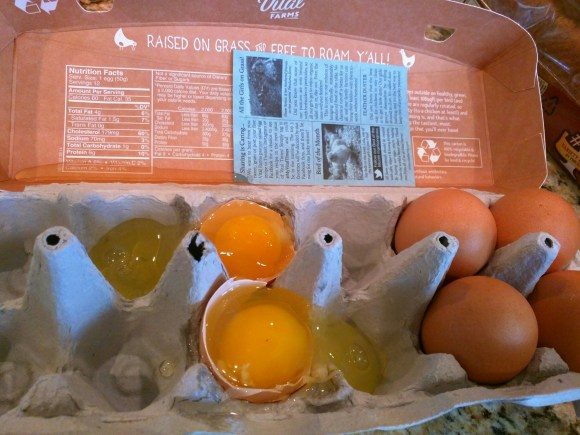 Broken eggs glued into carton.