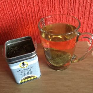 Marvellous Mango tin and mug of steeped tea