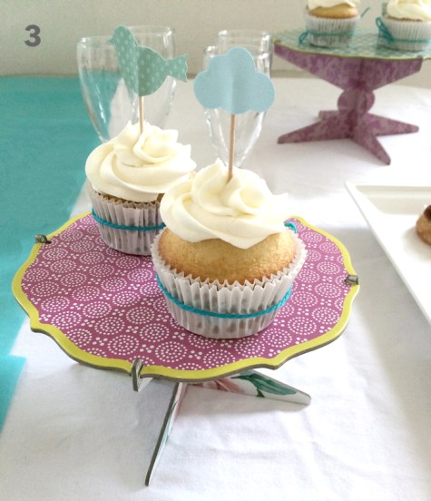 Serve and decorate with cupcakes. Add bakers twine around the cupcakes.