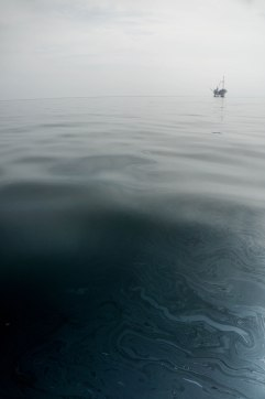 allegedly naturally seeped oil - that happens to be near an offshore oil rig that is out of commission because of a big spill it had a few years ago.