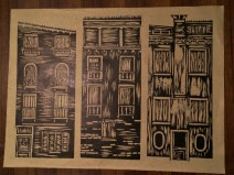 three buildings cmposition on brown paper