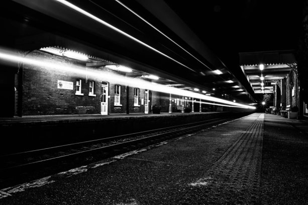 train_station_light_trail_bw_by_danjufo_photography-d893uzf.jpg