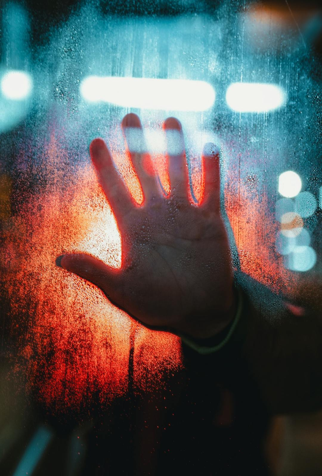 misty hand pressing against a glass