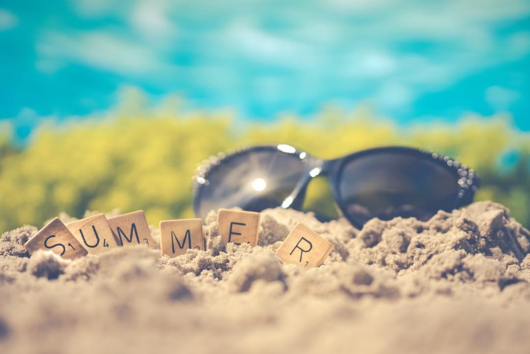 Sunglasses in beach sand