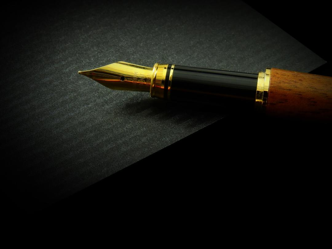 a pen in a black background
