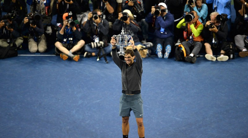 Rafael Nadal wins the 2013 US Open over top seed Novak Djokovic 6-2, 3-6, 6-4, 6-1 and holds up the winner's trophy.