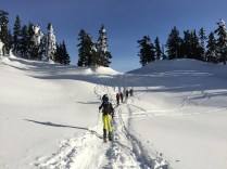 Making our way to Elfin - a group ski touring ahead of us and J. off to the side
