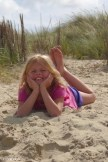 Girl lying in the Sand