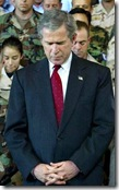 George W Bush praying