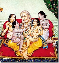 King Dasharatha with his four sons