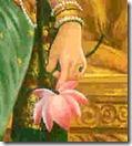Sita Devi holding flower