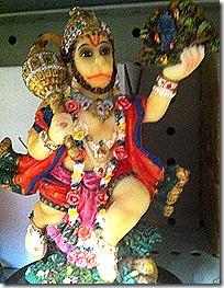 Shri Hanuman lifting a mountain