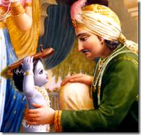 [Krishna bringing slippers to Nanda]