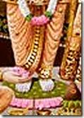 [Worshiping Rama's feet]