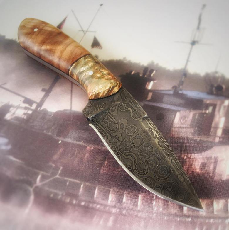 Backwoods Damascus steel fixed blade with burl handle.
