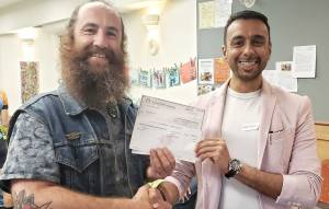 Project leader Kris Krüg accepts the grant check from Vancouver Foundation's Neighbourhood Small Grants program for the Feelmore Plants Pop-Up Project.