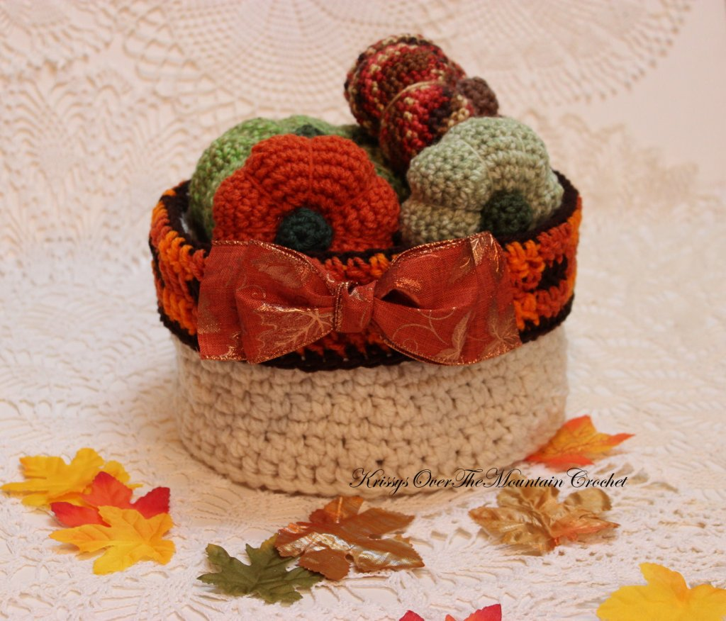 round basket with pumpkins