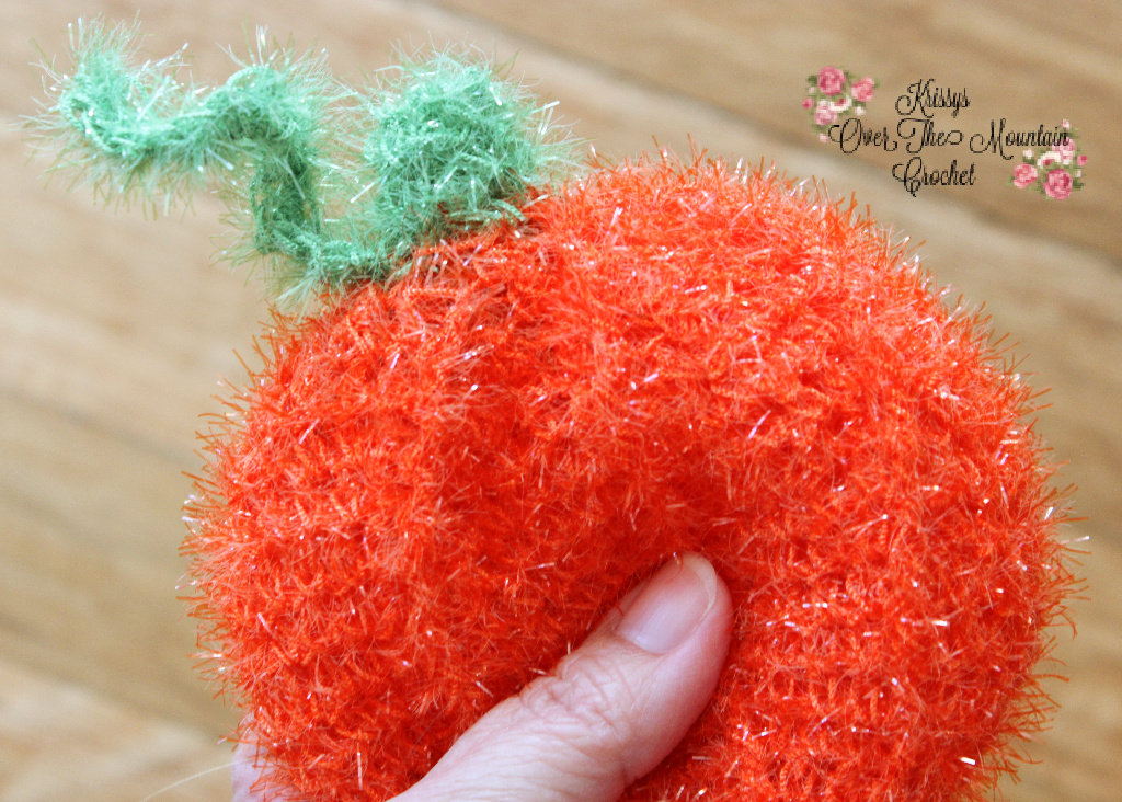 Pumpkin Pot Scrubber crocheted with Red Heart Scrubby Sparkle Yarn