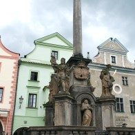 Fountain statues in front of coloured buildings