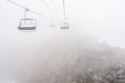 Chair lifts in clouds