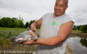 Fermin Diaz with a blue catfish caught in the Anacostia River.