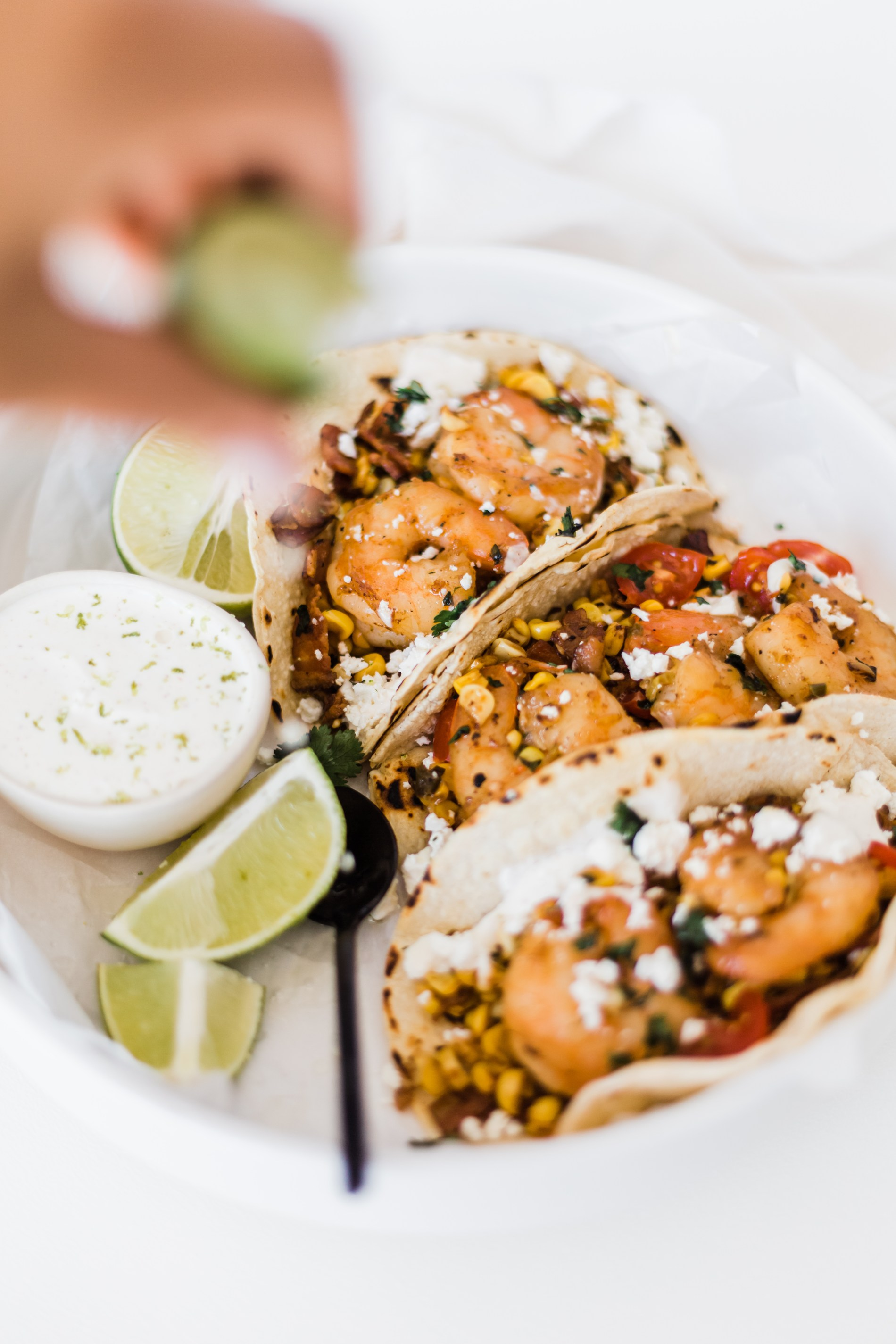 Shrimp & bacon tacos with corn, lime crema, and crumbled feta cheese | #shrimptacos #tacotuesday #bacon #seafood #easyrecipe