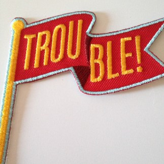 trouble red flag embroidered patch by kodiak milly on etsy2