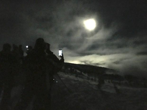 moonlight snowshoe cellphone crowd