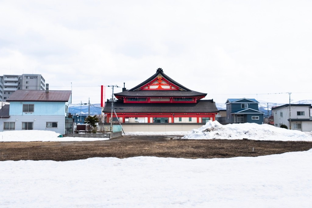 Snow covered red temple in Hokkaido, Japan