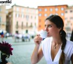 Contiki campaign brunette model drinking coffee in Rome