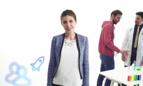 Corporate presenter in white top and blue jacket