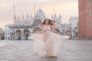 Woman dancing in San Marco Square Italy