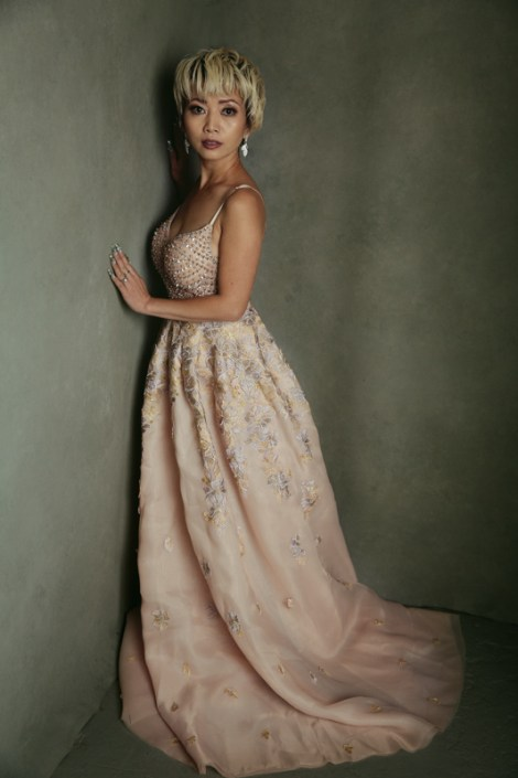 Beautiful Asian woman in a glamorous pink gown