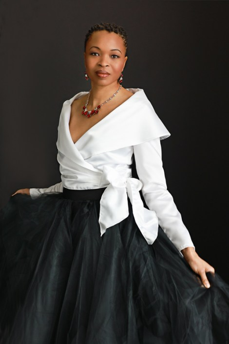 Portrait of a black young woman in a formal dress.