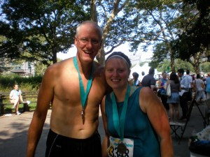 Katie & Phil after completing a half-marathon before his diagnosis. Katie says he keeps his medal by his bed every night.