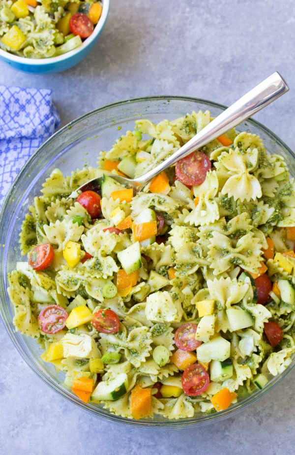 Make this colorful PESTO PASTA SALAD for your next BBQ or potluck! It's full of healthy vegetables all coated in a basil pesto sauce!