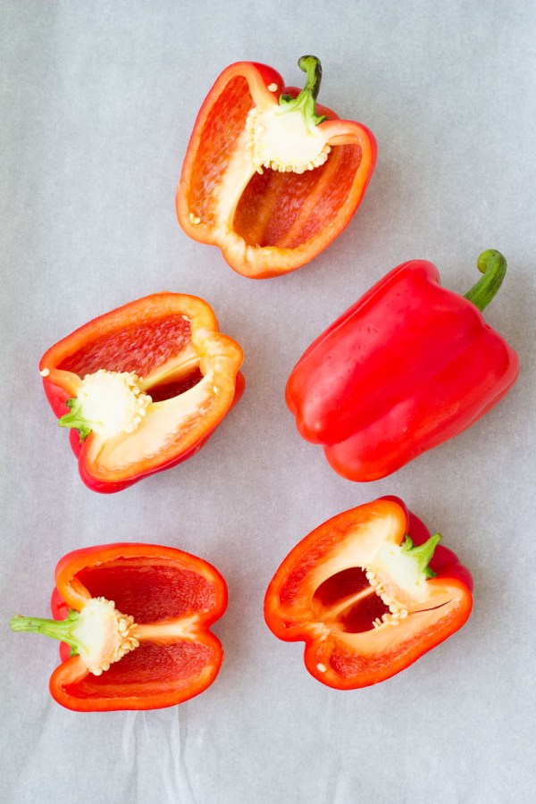 Red bell peppers cut in half.