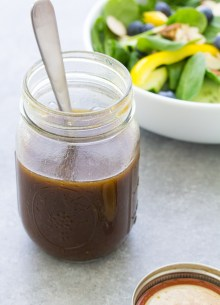 Easy balsamic vinaigrette recipe in a jar with a spoon.