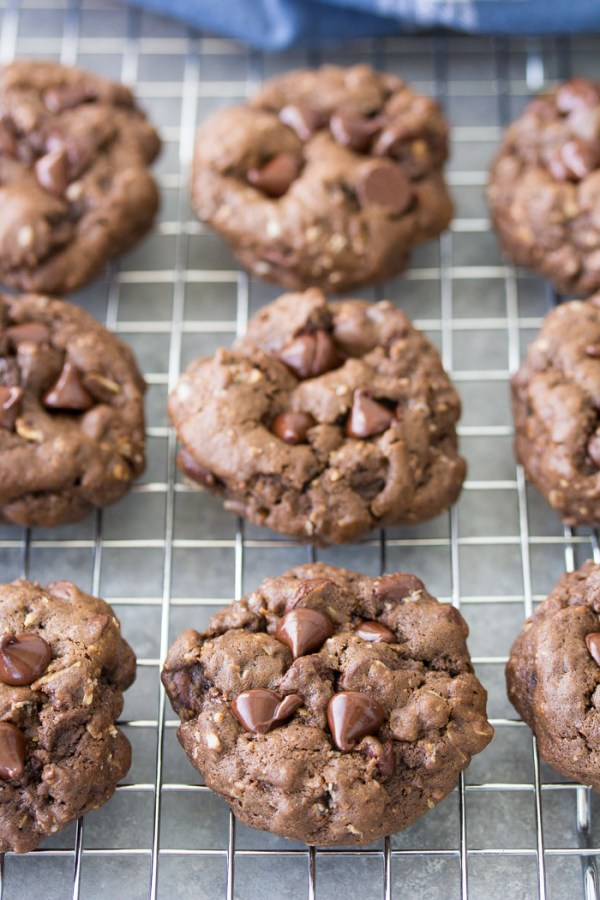 Chocolate oatmeal cookies on a cooling rack.