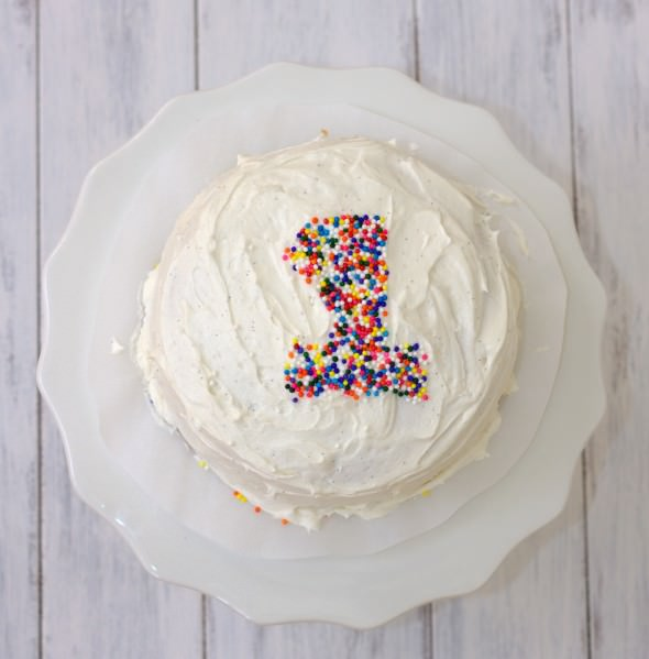 smash cake with white frost and sprinkles forming a number 1