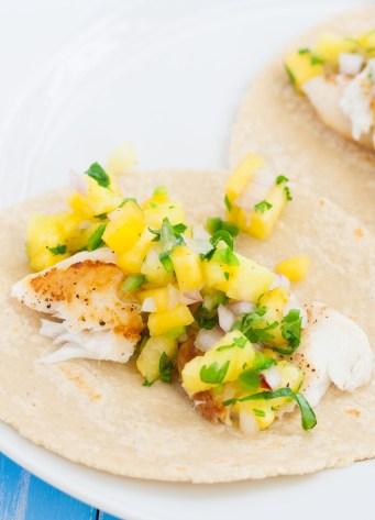Close up of tilapia fish tacos with pineapple salsa.