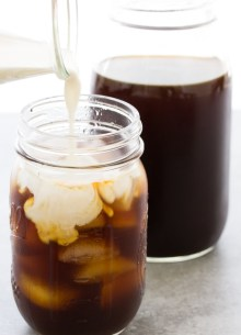 How to make cold brew coffee. Pouring cream into iced coffee.